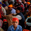 Pilgrims wait to be fed at a Sikh temple in New Delhi.