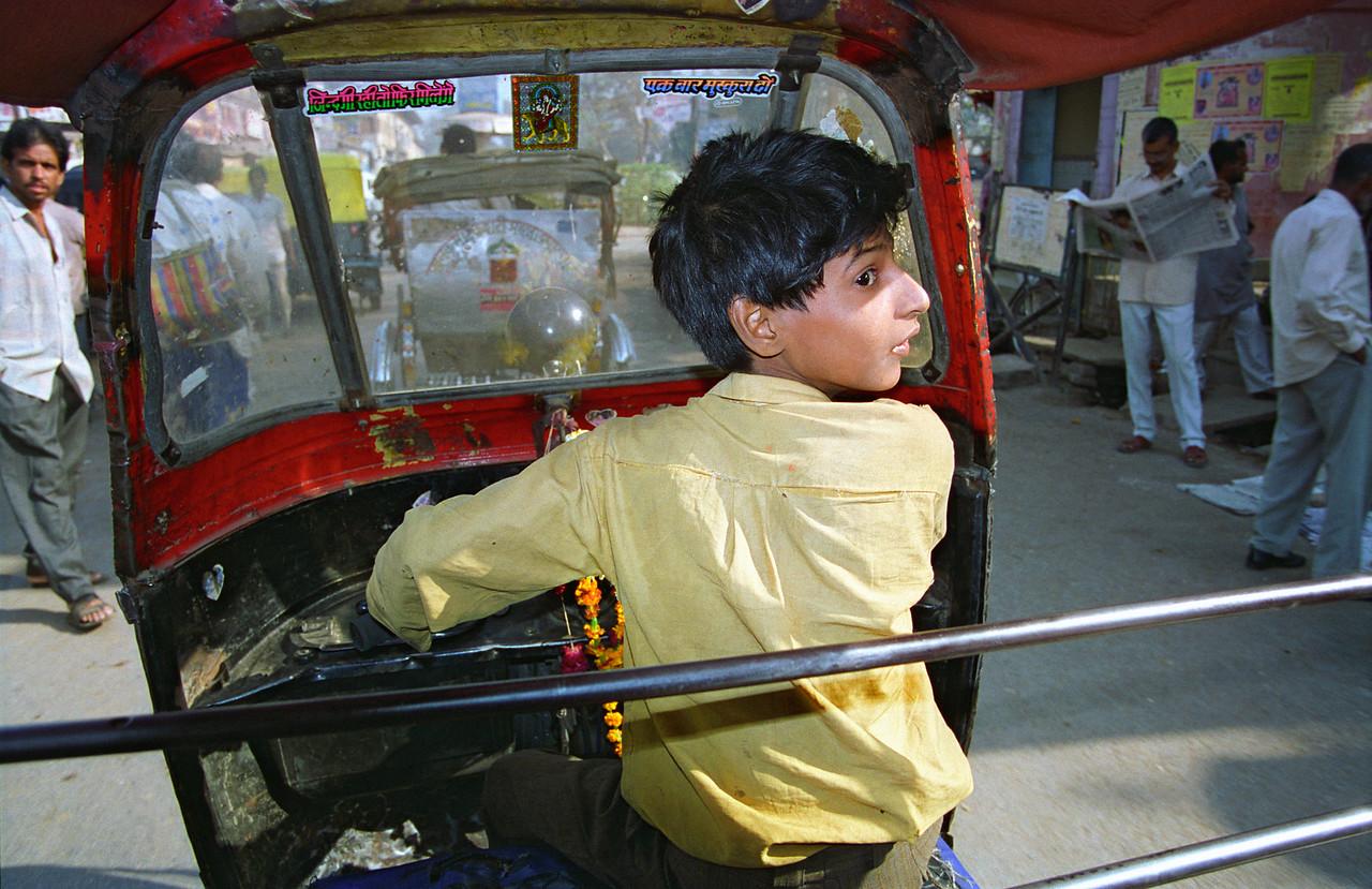 Young Rickshaw Driver
