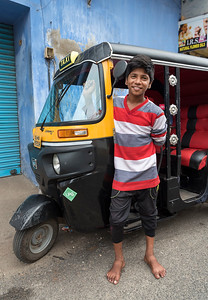 Boy with auto-rickshaw
