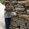 A young Ghangaria villager peaks out from his house