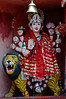 A small statue of the Hindu Goddess Durga