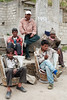 Village porters wait to carry tourists into the hills