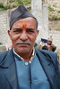 A village porter wearing a hat similar to those worn in Nepal