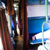 Inside of the Train, beds are stacked 3 high