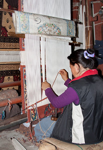 weaving carpets at a Tibetan refugee camp in Nepal