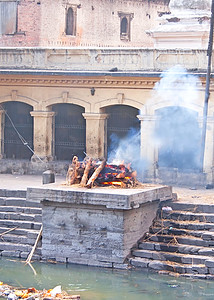A cremation on a ghat in Nepal