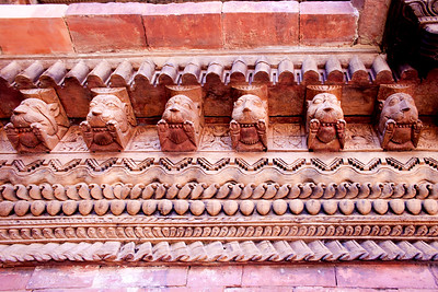 a frieze of lions in Nepal