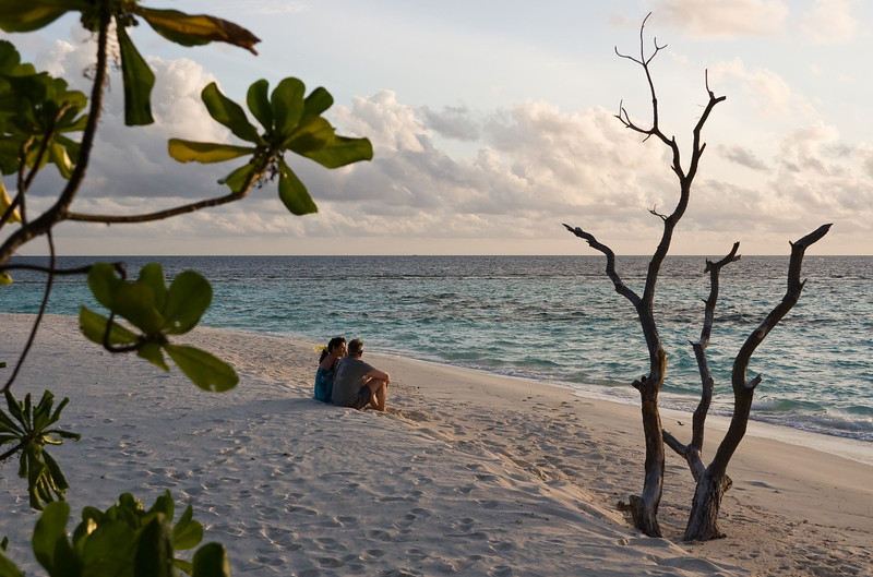 A couple enjoying the sunset on the beach.<br /> <br /> Location: Royal Island Resort, Maldives<br /> <br /> Lens used: 28-135mm f3.5-5.6 IS