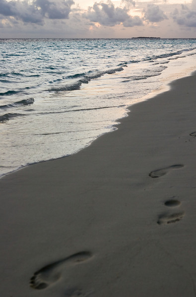 [My] Footprints in the evening sand.<br /> <br /> Location: Royal Island Resort, Maldives<br /> <br /> Lens used: 28-135mm f3.5-5.6 IS