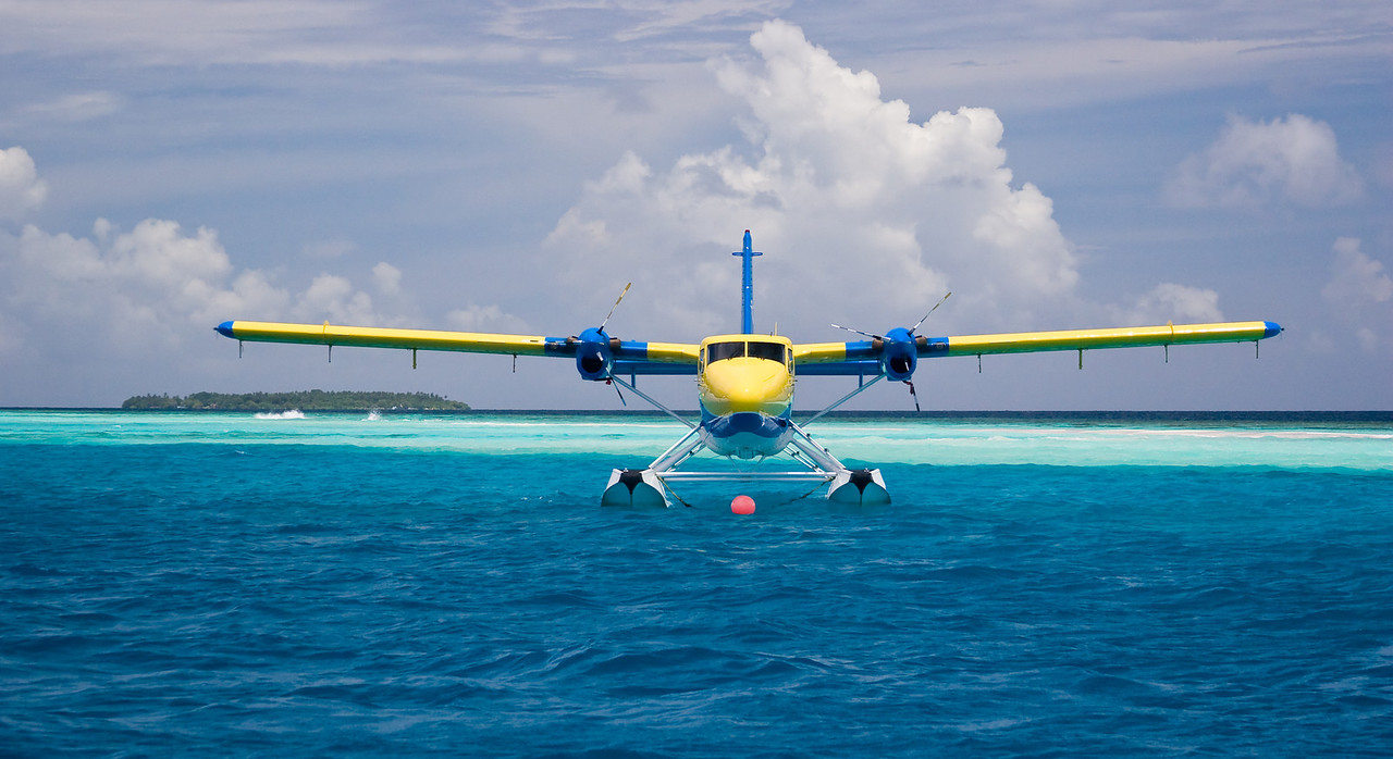 A parked plane bobs in the emerald-colored water off our island home.<br /> <br /> Location: Royal Island Resort, Maldives<br /> <br /> Lens used: 28-135mm f3.5-5.6 IS
