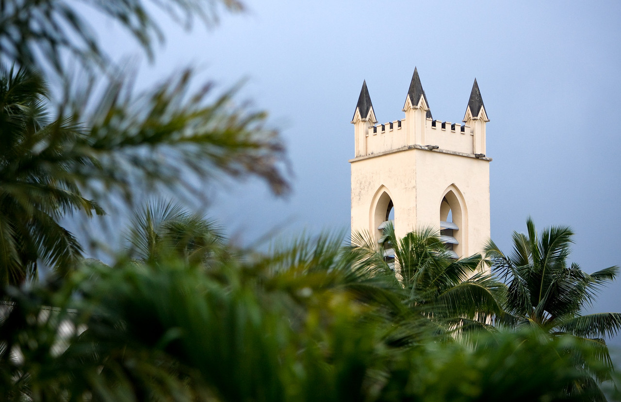 A church spire amongst palm trees.<br /> <br /> Location: Mahé island, Seychelles<br /> <br /> Lens used: 70-200mm f2.8 IS