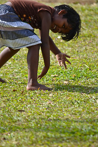 A little girl playing in the grass outside the temple