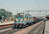 A lengthy train passes south through Mathura Junction on 9 March 1992 behind WAM4p 20560