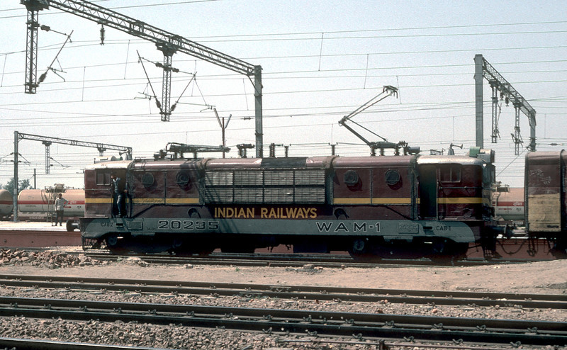 The earliest AC electric locomotives were supplied by a consortium of manufacturers from Europe. An example is WAM1 20235 seen here at Mathura Junction on March 9 1992
