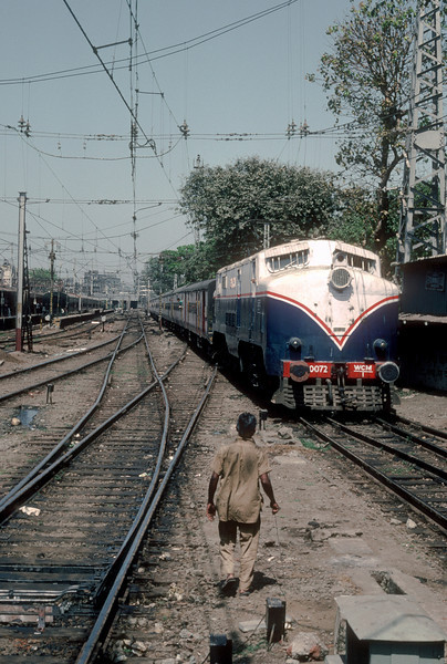 Built in Newton-le-Willows and Manchester by English Electric and Vulcan Works, WCM1 20072 was one of just seven of this class supplied in 1955. It is seen entering Bombay VT on 6 March 1992 looking very spruce in a new coat of paint