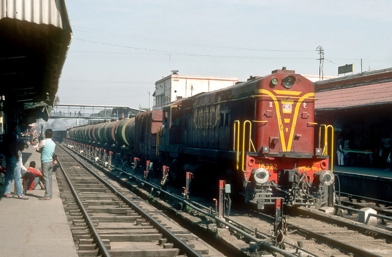 WDM2A 16322 passes through Bareilly Junction with a train of tank wagons on 18 March 1992