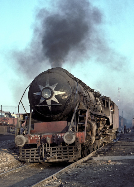 The evening light picks out WP7103 as it shuttles up and down the yard at Saharanpur on 17 February 1992