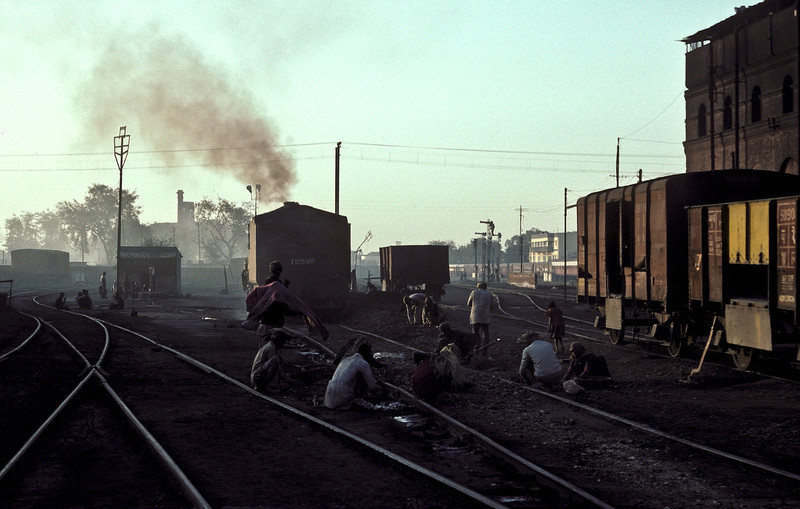 The local coal pickers go about their business giving little attention to WP7103 in the background at Saharanpur on 17 February 1992