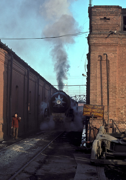 WP7615 passes between the heavy repair shops on the left and the running shed on the right at Saharanpur on 17 February 1992