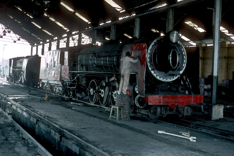 Hand-painted means exactly that - if you are lucky you get a cloth with which to apply it. YP2612 is seen at Mahesana Junction depot on 4 March 1992 being repainted after maintenance