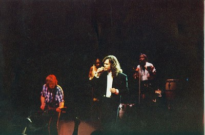 Mellencamp at Terre Haute's Hulman Center.  This was the opening show for his Lonesome Jubilee Tour on April 30, 1987.  I took this photo with my old Pentax K1000 from about the 15 row on the floor of Hulman Center.