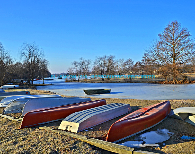 "Brightly colored boats on the edge of a frozen lake with a bright blue sky and the frozen lake in the background.<br /> <br /> bluemoon1236, smugmug <a href=""http://bluemoon1236.smugmug.com/Indiana-sights"">http://bluemoon1236.smugmug.com/Indiana-sights</a> ,Bluemoon Fine Photography"