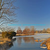 "Partially frozen lake surrounded by trees and shrubs with bright blue sky in the background.<br /> <br /> bluemoon1236, smugmug <a href=""http://bluemoon1236.smugmug.com/Indiana-sights"">http://bluemoon1236.smugmug.com/Indiana-sights</a> ,Bluemoon Fine Photography"