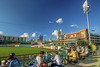 People enjoy the view from picnic tables along the first base line during a Tincaps minor league baseball game at Parkview Field in Fort Wayne, IN on Wednesday, August 12, 2015. Copyright 2015 Jason Barnette