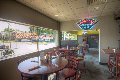 Several tables with a view of the small neighborhood at The Acme in Fort Wayne, IN on Thursday, August 13, 2015. Copyright 2015 Jason Barnette