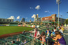 People enjoy the view from picnic tables along right field during a Tincaps minor league baseball game at Parkview Field in Fort Wayne, IN on Wednesday, August 12, 2015. Copyright 2015 Jason Barnette