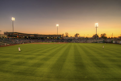 The sun sets during a Tincaps minor league baseball game at Parkview Field in Fort Wayne, IN on Wednesday, August 12, 2015. Copyright 2015 Jason Barnette