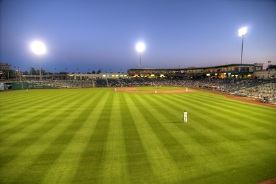 A day game becomes a night game during a Tincaps minor league baseball game at Parkview Field in Fort Wayne, IN on Wednesday, August 12, 2015. Copyright 2015 Jason Barnette