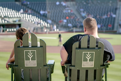 Early arrivals snag the comfortable chairs for a Tincaps minor league baseball game at Parkview Field in Fort Wayne, IN on Wednesday, August 12, 2015. Copyright 2015 Jason Barnette