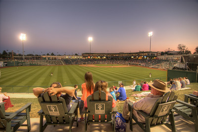 People enjoy the late evening light during a Tincaps minor league baseball game at Parkview Field in Fort Wayne, IN on Wednesday, August 12, 2015. Copyright 2015 Jason Barnette