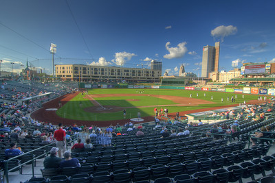People begin to arrive for a Tincaps minor league baseball game at Parkview Field in Fort Wayne, IN on Wednesday, August 12, 2015. Copyright 2015 Jason Barnette