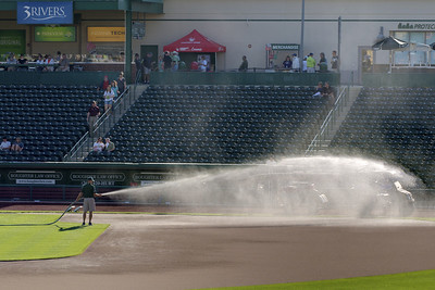 Workers prepare the field before a Tincaps minor league baseball game at Parkview Field in Fort Wayne, IN on Wednesday, August 12, 2015. Copyright 2015 Jason Barnette