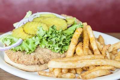 An enormous breaded tenderloin sandwich at The Acme in Fort Wayne, IN on Thursday, August 13, 2015. Copyright 2015 Jason Barnette
