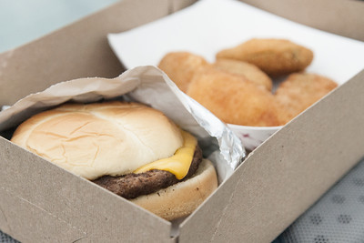 A simple cheeseburger and delicious jalapeno poppers in a cardboard box at the Auburn-Garrett Drive-In Theater in Garrett, IN on Saturday, August 8, 2015. Copyright 2015 Jason Barnette