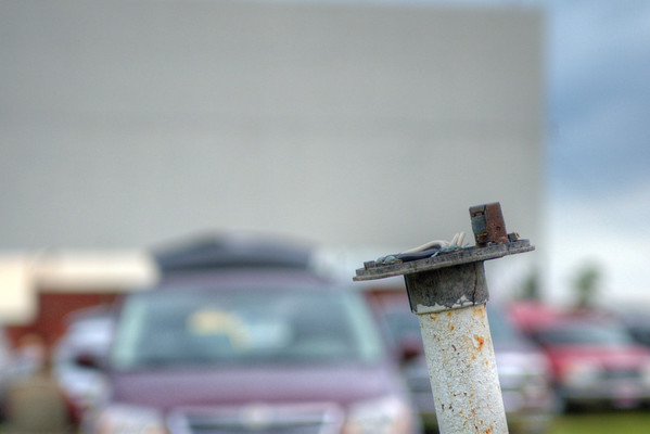 An empty pole between parked cars shows how the old tradition of wired speakers have given way to in-car stereos at the Auburn-Garrett Drive-In Theater in Garrett, IN on Saturday, August 8, 2015. Copyright 2015 Jason Barnette