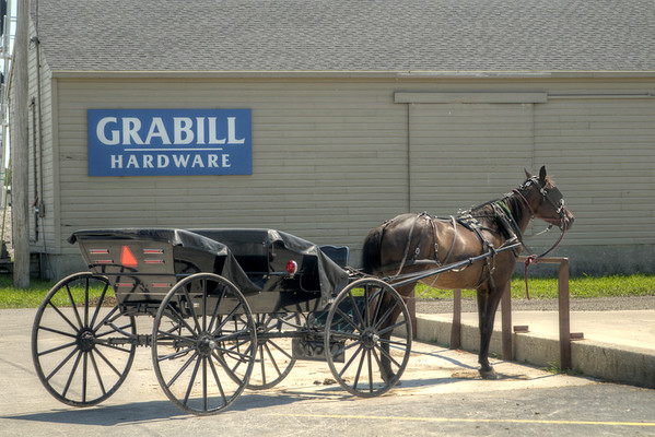 A horse drawn carriage in a parking space, a common sight, at the Grabill Hardware store in Grabill, IN on Thursday, August 13, 2015. Copyright 2015 Jason Barnette