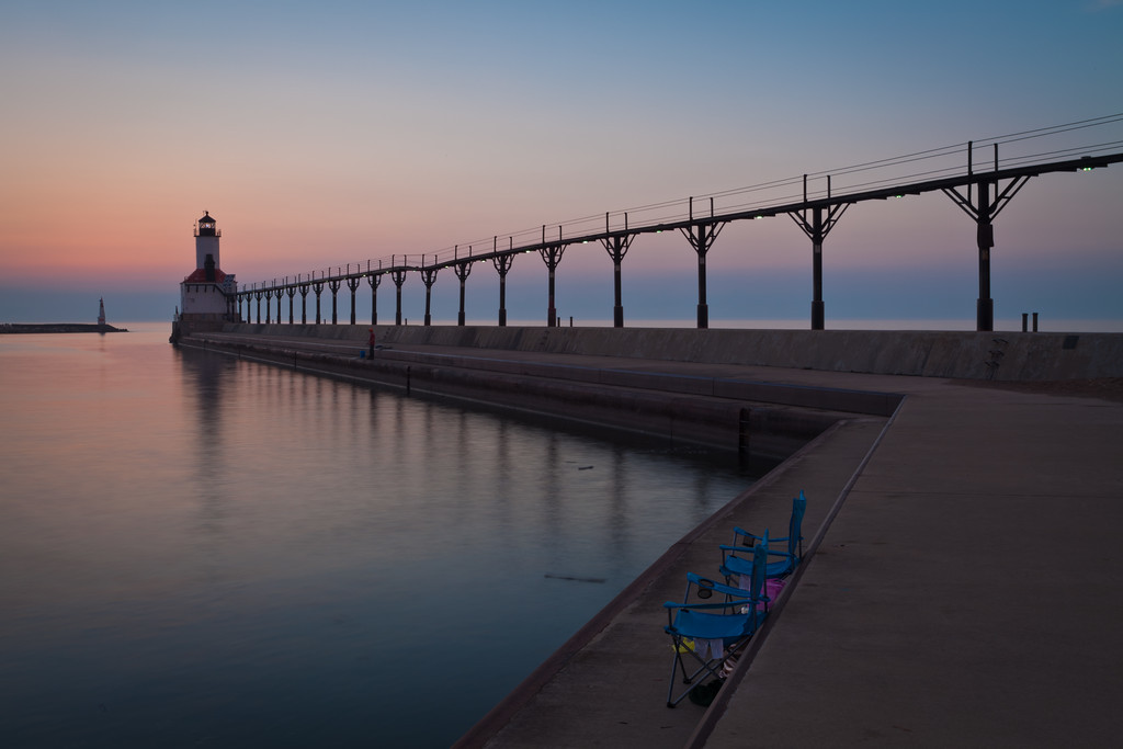 Many locals enjoy walking around the Michigan City Light pier. Others just like to fish or just sit and enjoy the setting sun. Michigan City, IN<br /> <br /> IN-100531-0090
