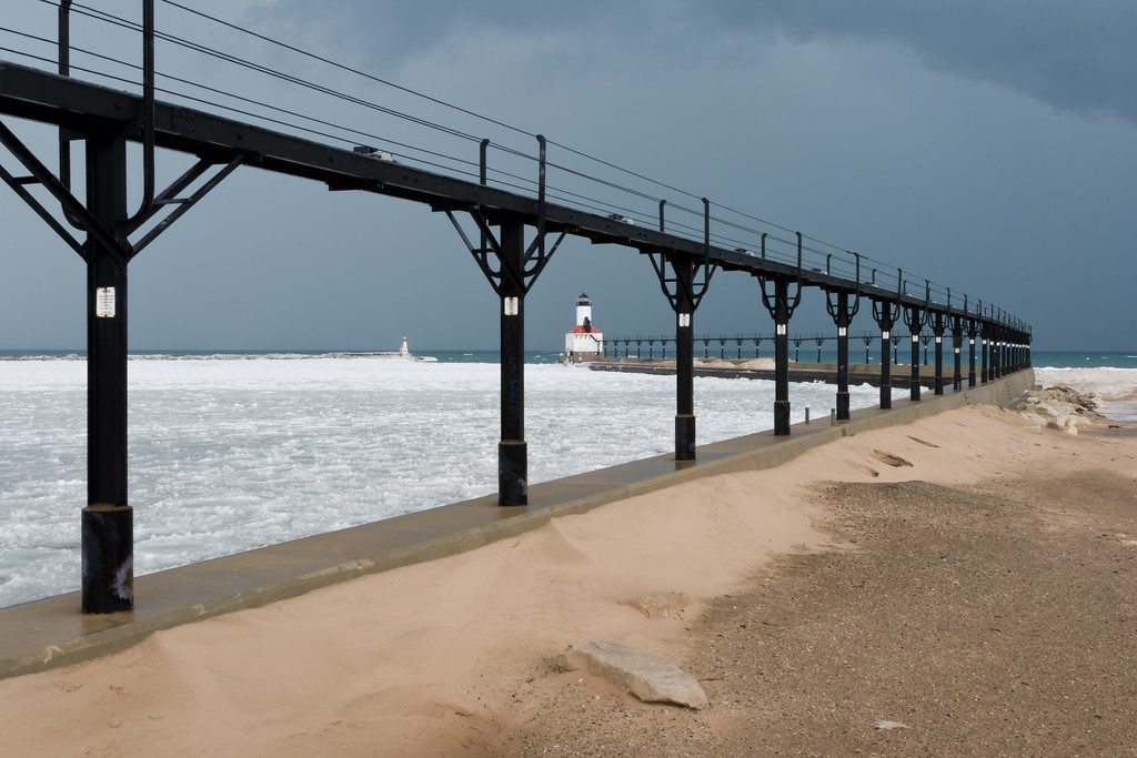 The frozen waters of the marina channel can be seen through the Michigan City Light catwalk. Michigan City, IN<br /> <br /> IN-080217-0107