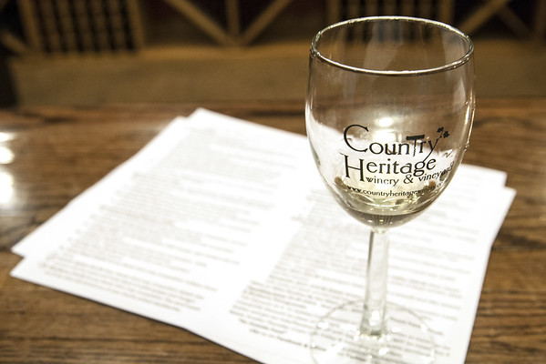 A glass of wine along with a list during a sample tasting at Country Heritage Winery & Vineyard in Laotto, IN on Tuesday, August 11, 2015. Copyright 2015 Jason Barnette