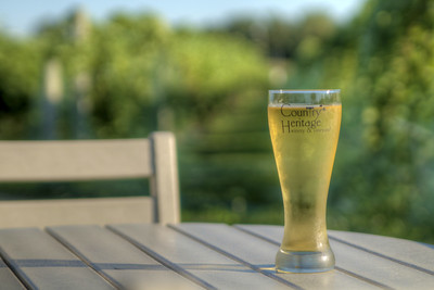 A tall glass of hard apple cider on the outdoor patio at Country Heritage Winery & Vineyard in Laotto, IN on Tuesday, August 11, 2015. Copyright 2015 Jason Barnette