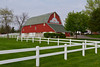 A red barn at the Sunshine Farm and Essenhaus in Middlebury, Indiana, USA.