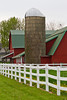 A red dairy barn with white fence in Middlebury, Indiana, USA.