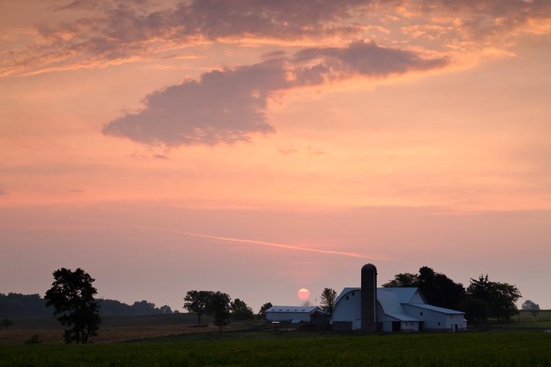 Rural sunrise over an Amish Farm near Goshen. Elkhart County, IN<br /> <br /> IN-100531-0001