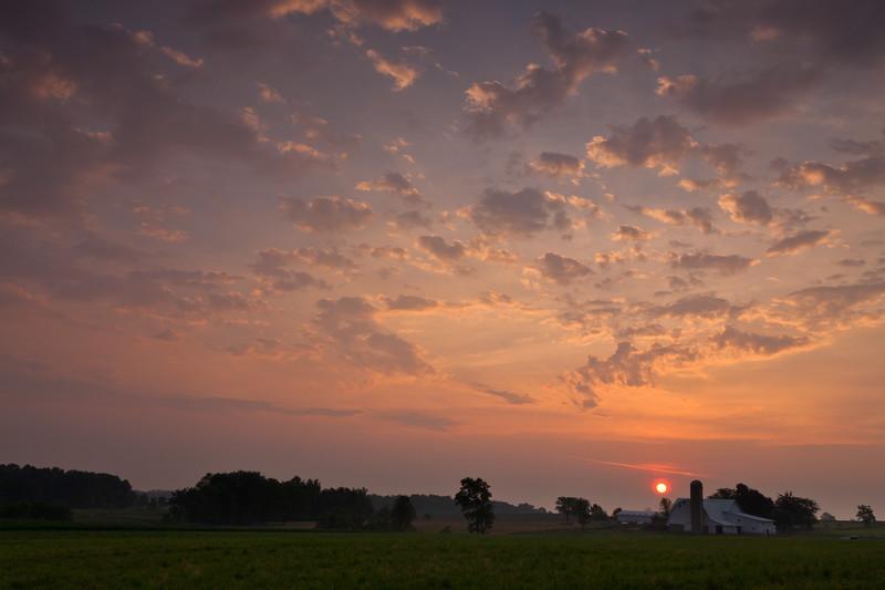 Rural sunrise over an Amish Farm near Goshen. Elkhart County, IN<br /> <br /> IN-100531-0015