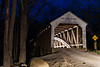 Car crossing the Cox Ford Covered Bridge light up the inside framework and entrance to the bridge. Parke County, IN<br /> <br /> IN-140426-0229