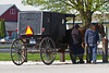 Amish and Mennonites with their horse and buggies at a hitchpost in Shipshewana, Indiana, USA.